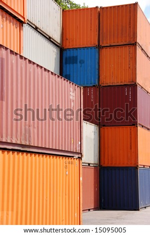 Stack of cargo container in different colors
