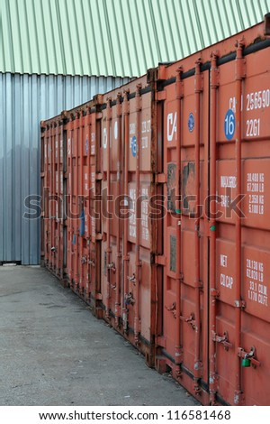 Stack of Cargo Containers at warehouse