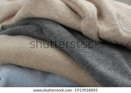Stack of cashmere clothes as background, closeup ストックフォト ©