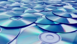 Stack of CD and DVD background.