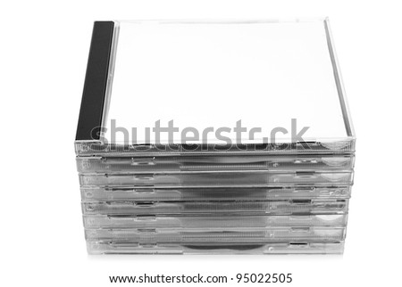 Stack of CD discs in boxes on white background