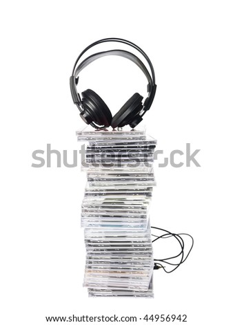 Stack of Cd`s and Headphones isolated on white background