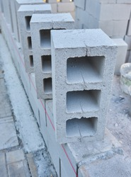 Stack of cement blocks at the construction site. cinder blocks background