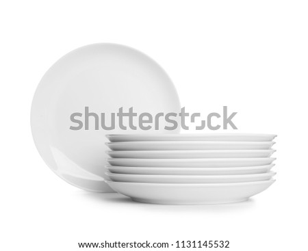 Stack of ceramic dishware on white background