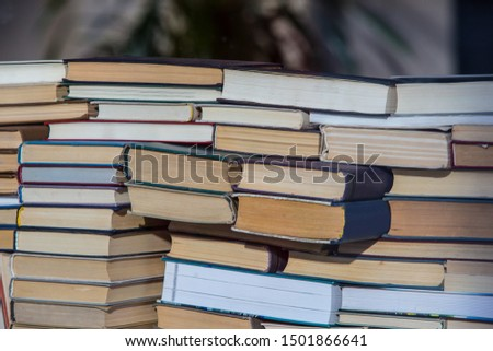 Stack of chaotically stacked books of different size and form. Close-up. #1501866641