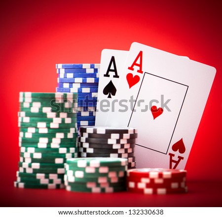 Stack of chips and two aces