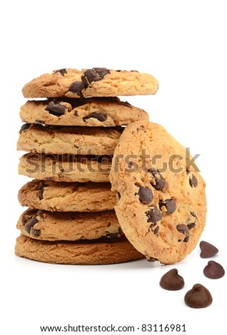 Stack of chocolate chip cookies and morsels on white background