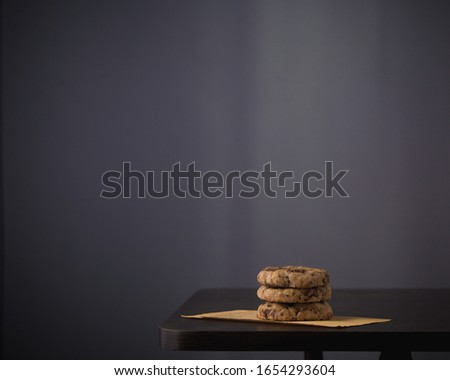 Stack of chocolate chip cookies on a table