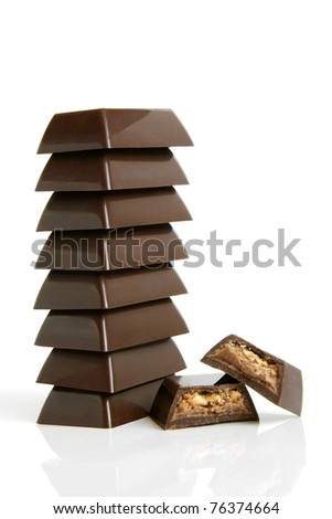 Stack of chocolate pieces on a white background