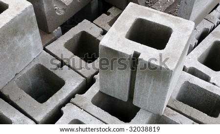 Stack of cinder blocks at a construction site.