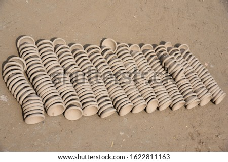 stack of clay made lanterns placed in the potter shop for sale