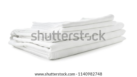 Stack of clean bed sheets on white background