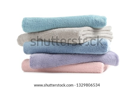 Stack of clean soft towels on white background #1329806534
