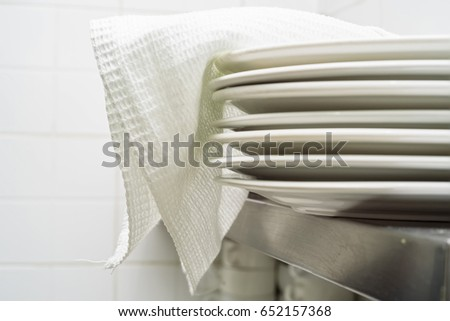Stack of clean white ceramics plates #652157368