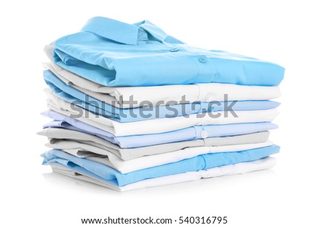 Stack of clothes on white background, closeup #540316795