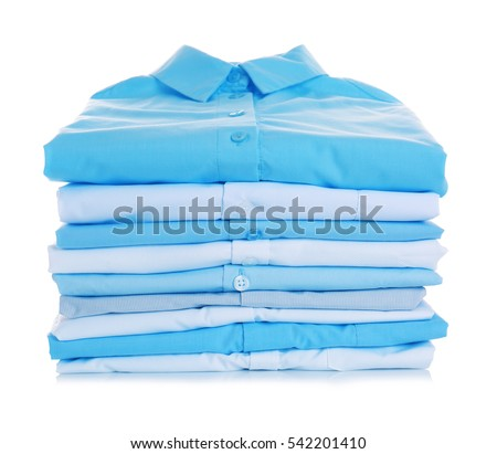 Stack of clothes on white background, closeup #542201410