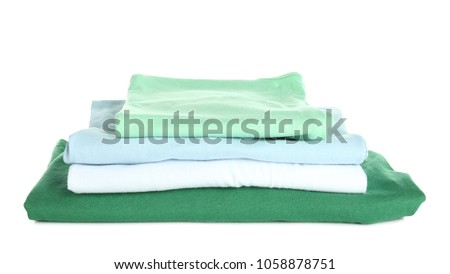 Stack of clothes on white background. Laundry day #1058878751