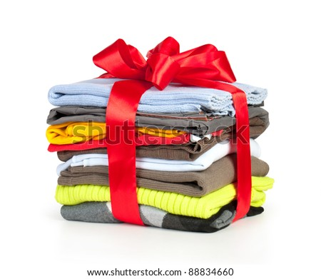 stack of clothing with red ribbon and bow