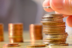 stack of coin on table background and saving money and business growth concept, finance and investment concept