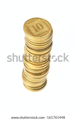 Stack of coins Israeli ten agorot in shallow DOF isolated on white background