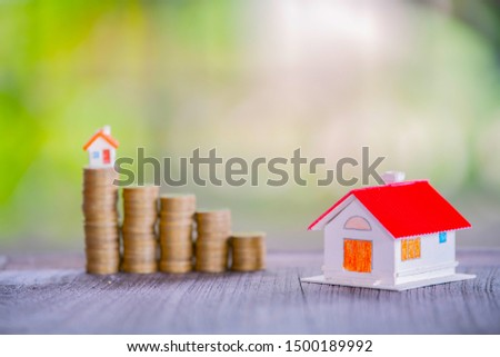 Stack of coins stacked with growth in the park, save money to buy houses and borrow for business investment for real estate concepts. The concept of saving and investing a pile of risky coins. The con