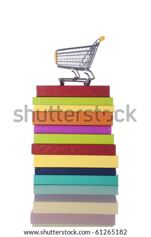 Stack of color books and a shopping cart (isolated on white)