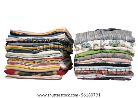 stack of colored t-shirts and shirt, front view, ironed and packed