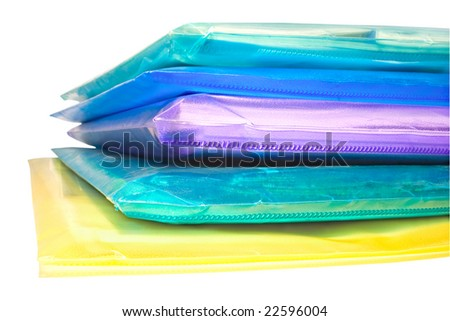 stack of colored vinyl document envelopes isolated on white
