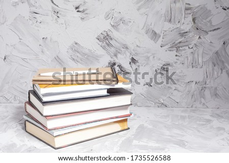 Stack of colorful books. An open book on a stack of books. The concept of education, international book day, success. Book, hardback colorful books on table. Education business concept.