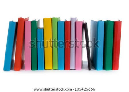 Stack of colorful books and E-book on white background