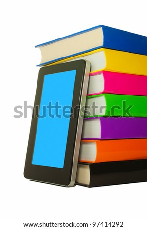 Stack of colorful books and tablet PC over white background