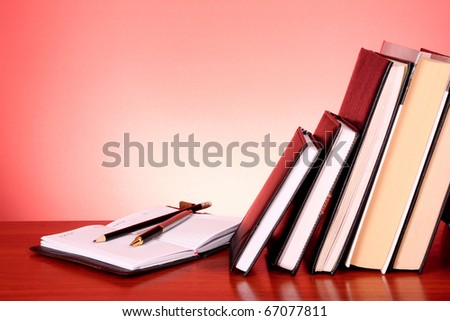stack of colorful books on the table