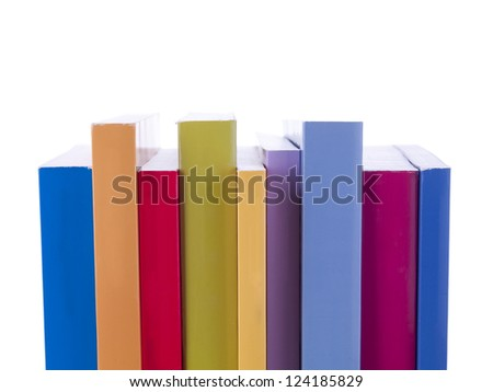 Stack of colorful books over a  white background
