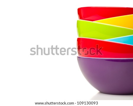 Stack of colorful bowls isolated on white background