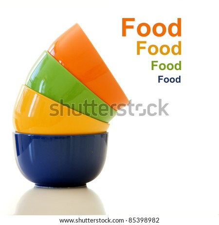 Stack of colorful  bowls on white background