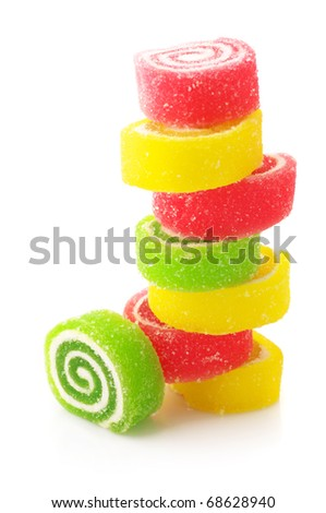 Stack of colorful candy isolated on white background.