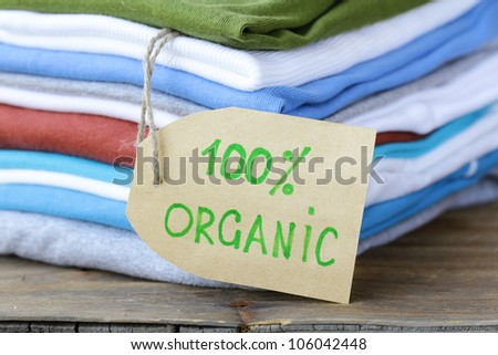 stack of colorful clothing with organic label
