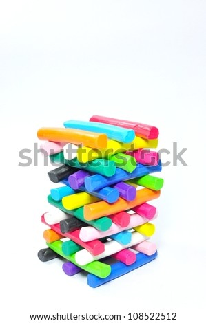 Stack of colorful plasticine on white background
