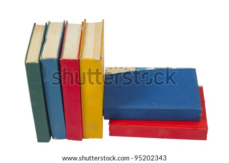Stack of colorful real books on white background