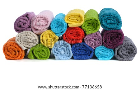 stack of colorful rolled towels   isolated on white background