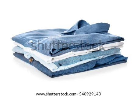 Stack of colorful shirts on white background #540929143