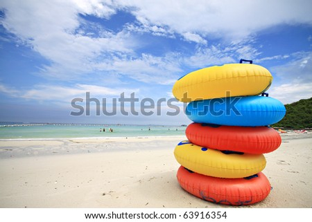 Stack of colorful swimming rings