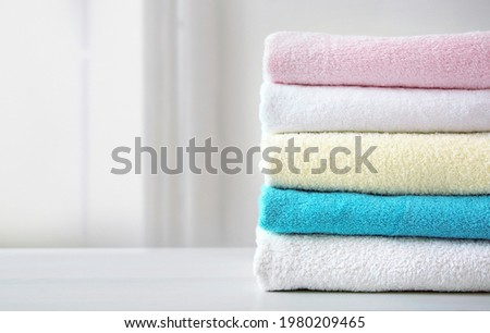 Stack of colorful terry towels empty space design. Colorful laundry.Household. Hygiene,wash items. Stockfoto ©