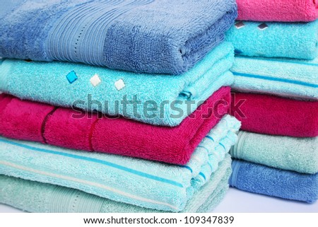 Stack of colorful towels, closeup picture.