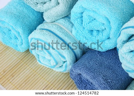 Stack of colorful towels isolated on mat background. - stock photo