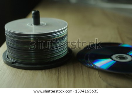Stack Of Compact Discs On A Table