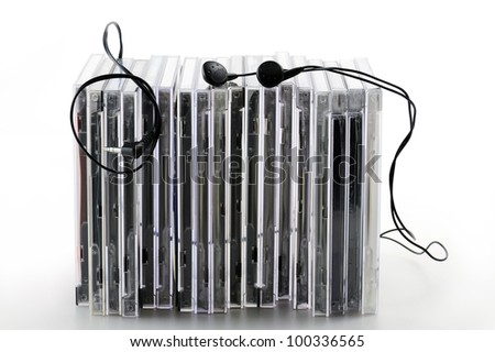 stack of compact disk with earphones, on white background