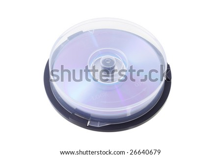 Stack of compact disks enclosed in plastic spindle case - stock photo