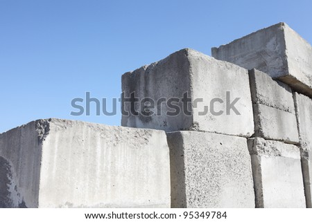 stack of concrete blocks, construction site against a blue sky Stock photo ©
