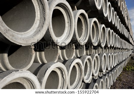 Stack of concrete drainage pipes with diminishing perspective